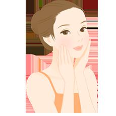 自宅で顔のマッサージをしている女性